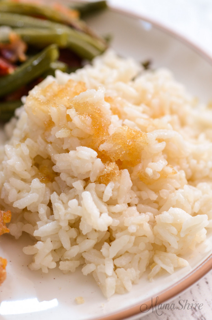 A serving of sweet white rice topped with brown sugar.