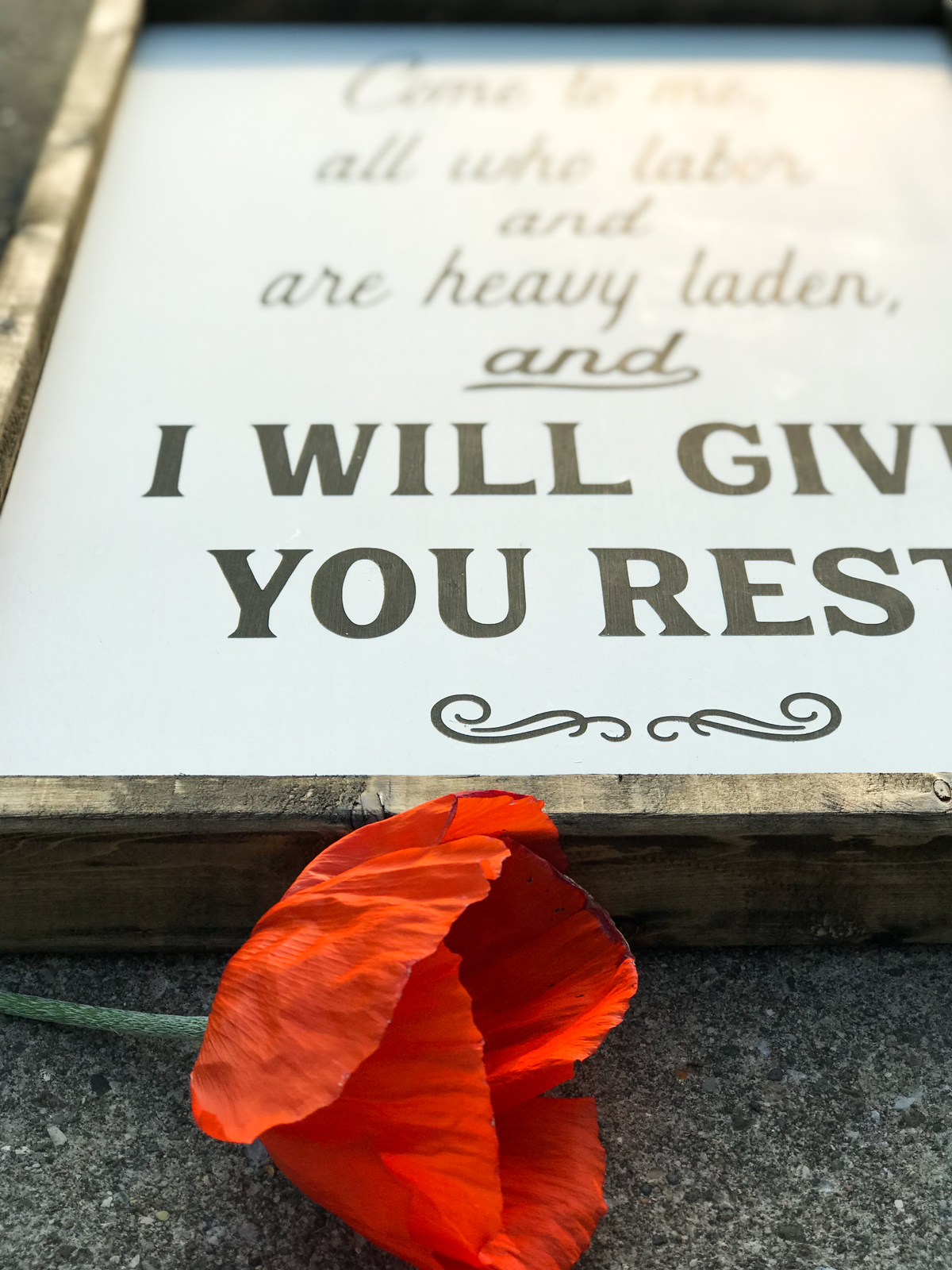 Wooden sign of I Will Give You Rest.
