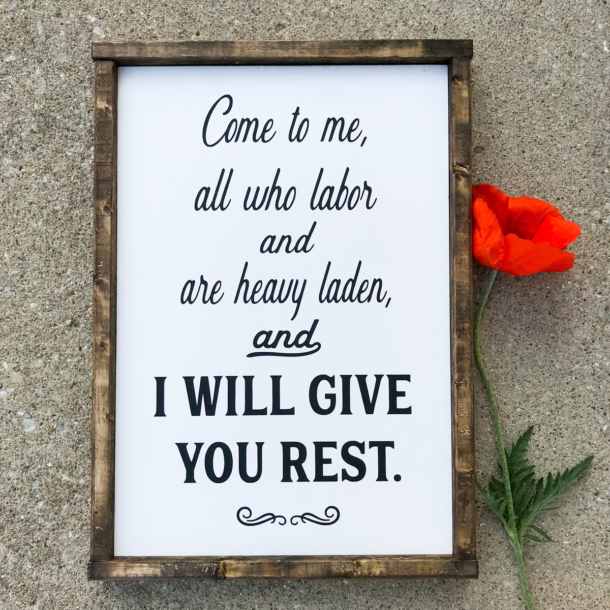 Wood sign of I Will Give You Rest.
