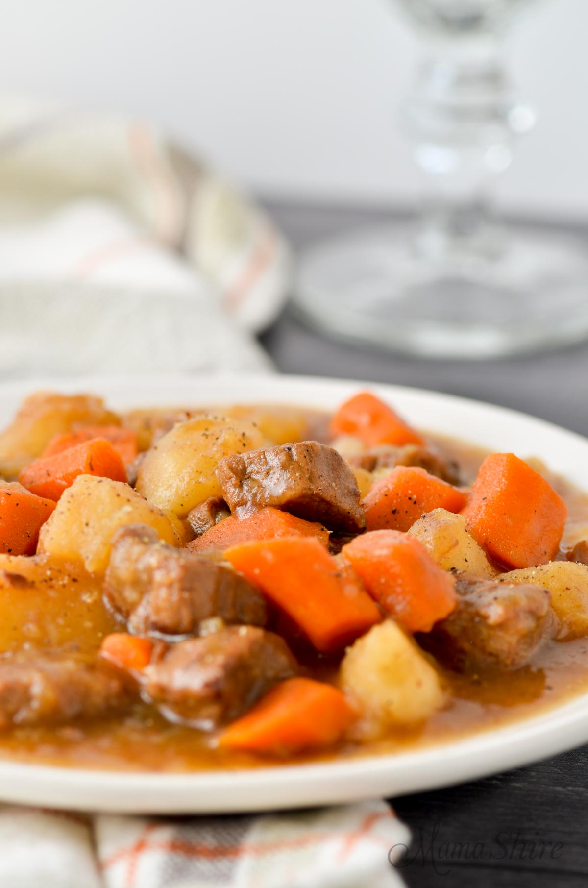 Instant Pot beef stew on a white plate.