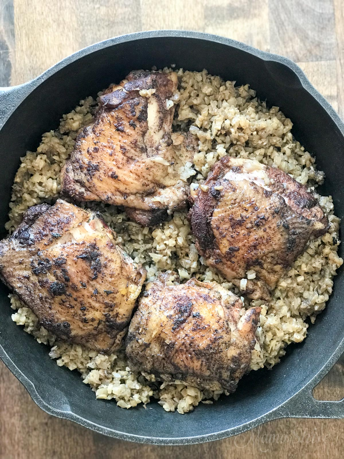 "One-pot Jamaican Jerk Chicken & ""Rice"" Dinner in a cast iron skillet."
