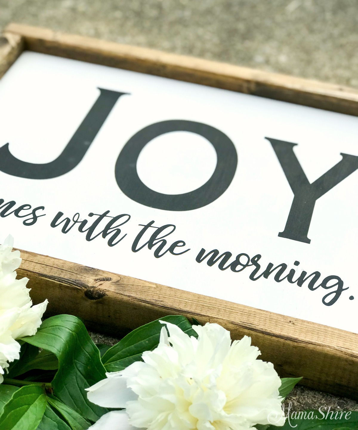 Joy comes with the morning wood sign.