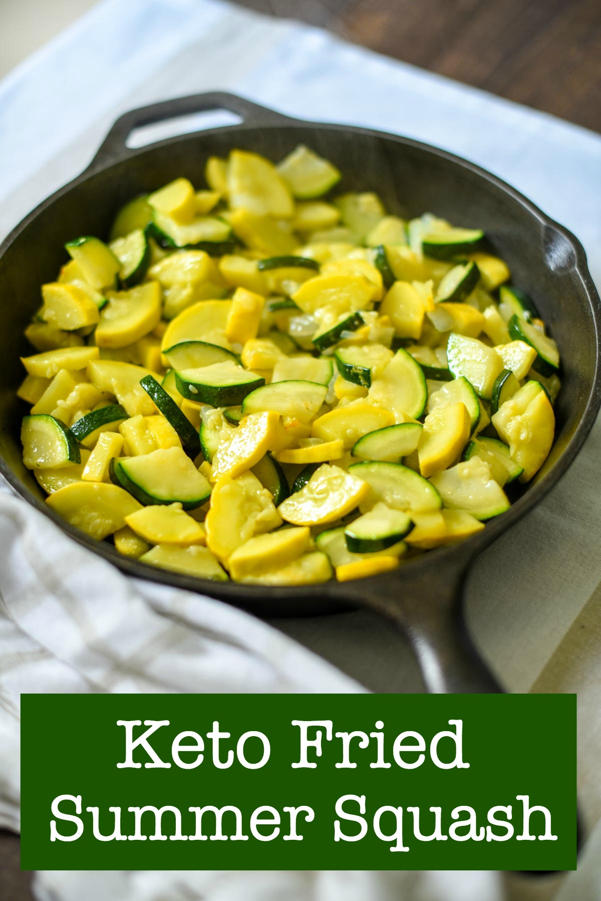 Fried summer squash in an iron skillet on plan with Trim Healthy Mama and keto.