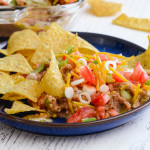 A plate of tortilla chips and dairy-free layered bean dip