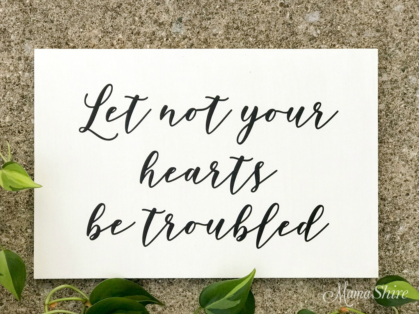 Let not your heart be troubled wood sign.