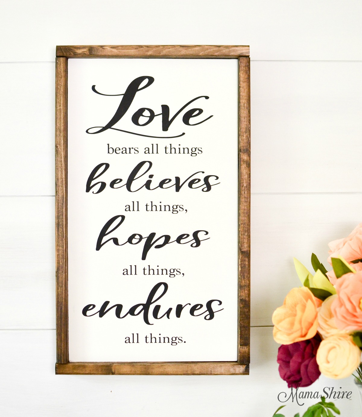 Love Bears All Things wooden sign with flowers.