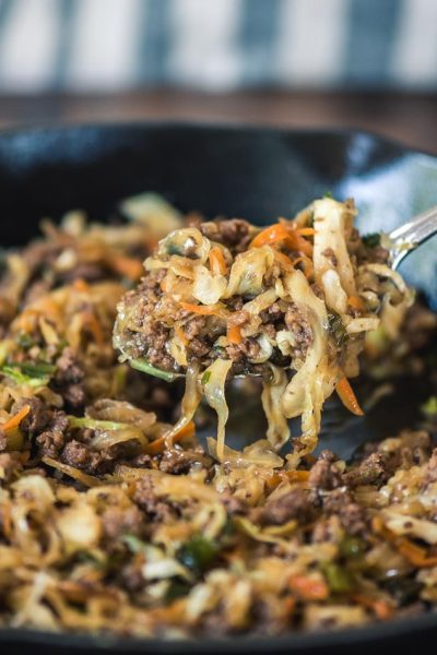 Mongolian Beef Egg Roll in a Bowl in a iron skillet.