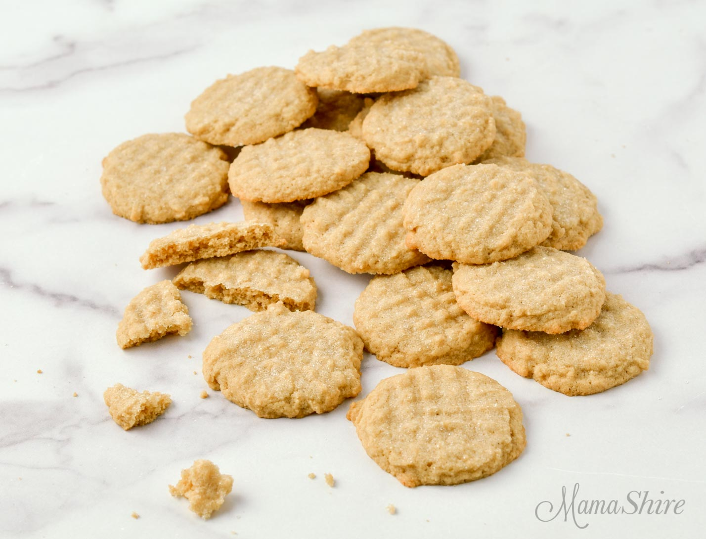 A pile of gluten-free and dairy-free peanut butter cookies.
