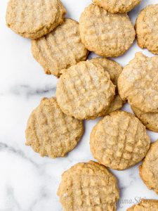 A pile of freshly baked gluten-free peanut butter cookies.