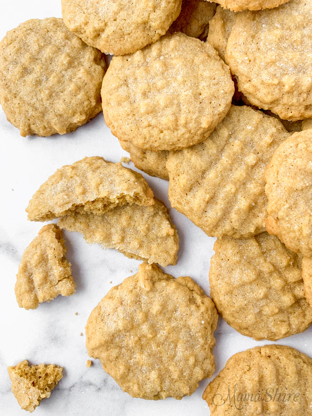 A pile of soft peanut butter cookies made from a gluten-free and dairy-free recipe.