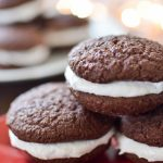 Peppermint whoopie pies on a red plate.