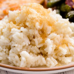 A plate with sweet rice made with almond milk and brown sugar.
