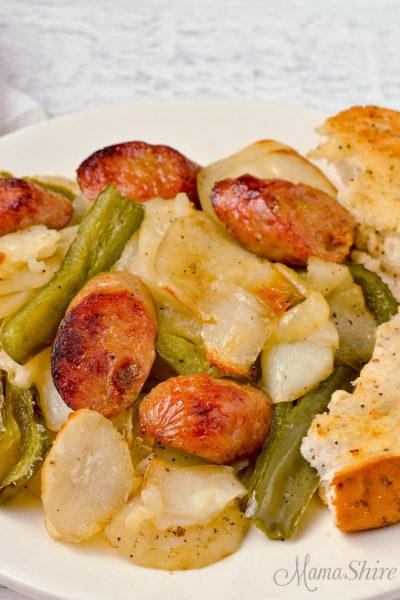 Roasted chicken sausage with potatoes and green peppers.