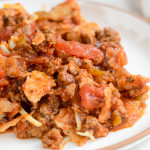 A closeup of a delicious dish called skillet enchiladas. An easy and quick gluten-free dinner.