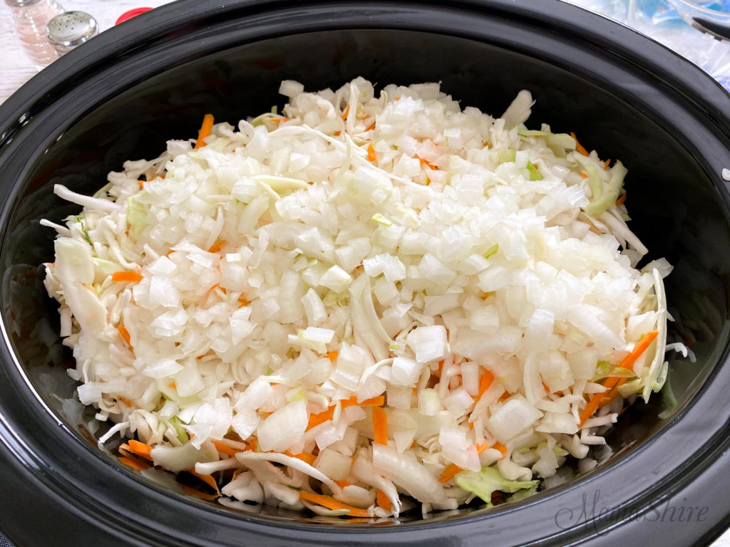 Coleslaw in the slow cooker on top of the other ingredients.
