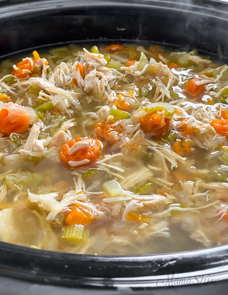 Slow cooker chicken soup with vegetables. easy to make chicken soup.