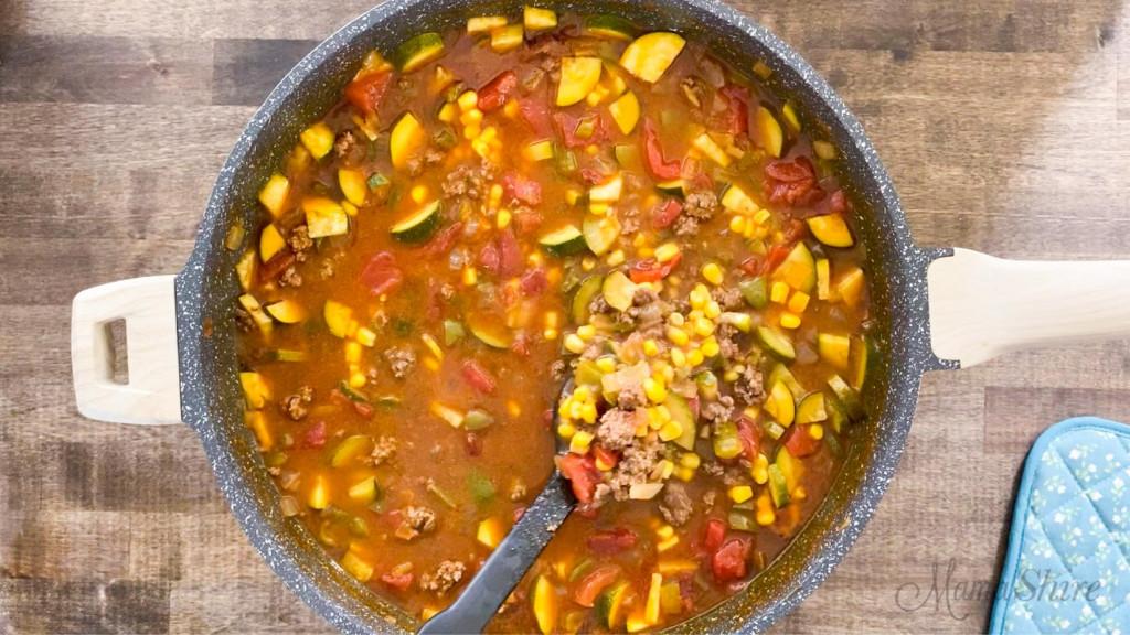 A big pot of taco soup with veggies.