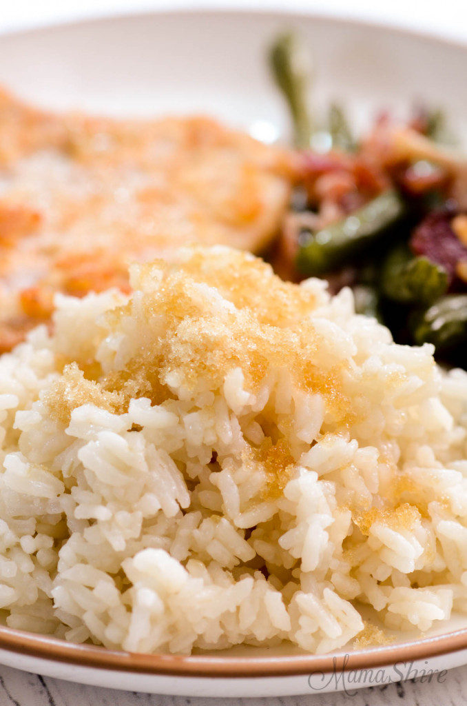 A serving of sweet rice made with almond milk and brown sugar on a dinner plate.