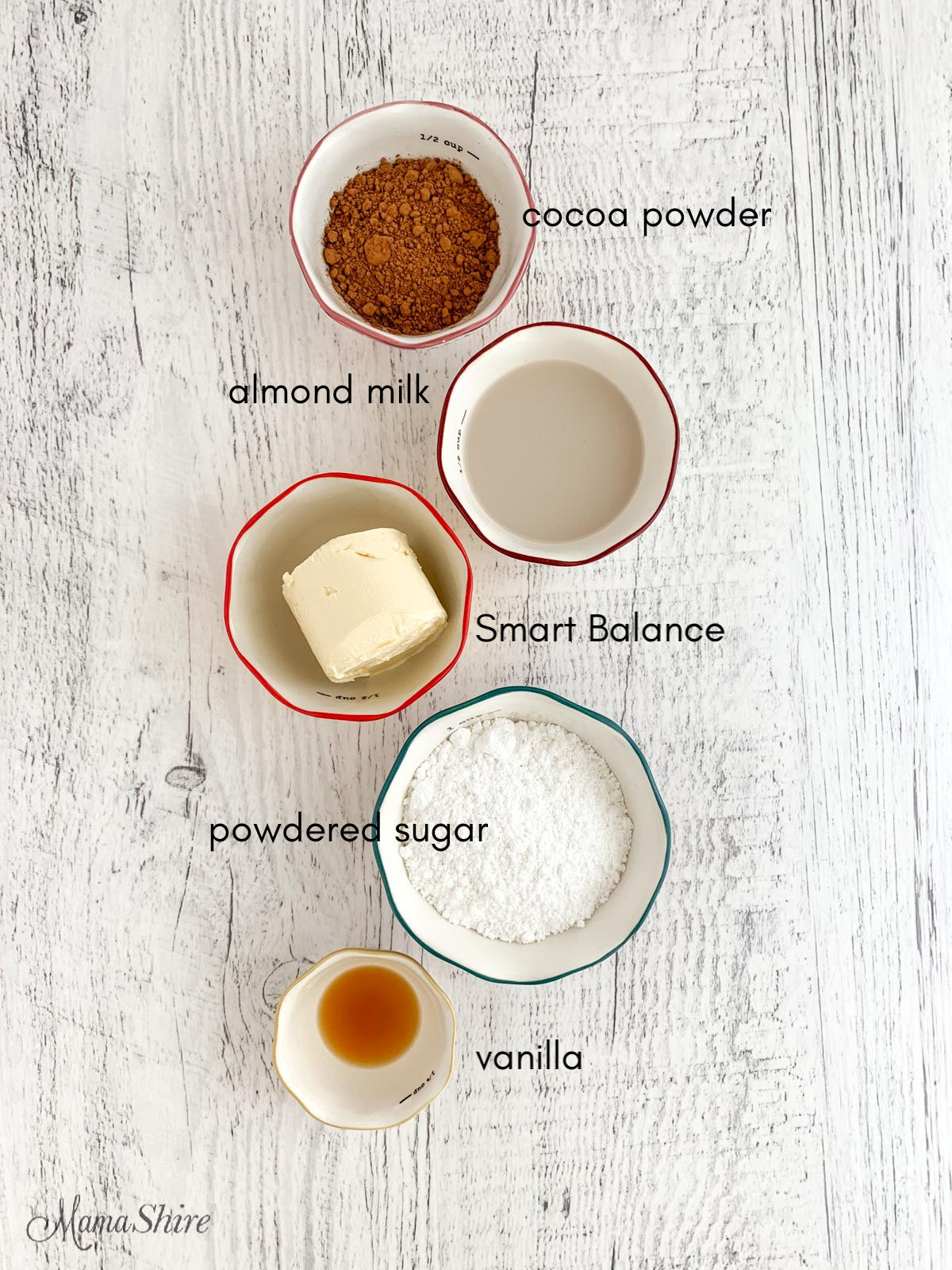Ingredients in prep bowls for chocolate icing.