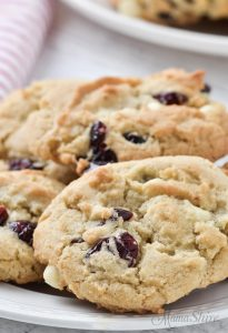 A close-up of a white chocolate cranberry cookie made gluten-free and dairy-free.
