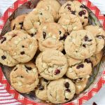 A Christmas plate of white chocolate cranberry cookies.